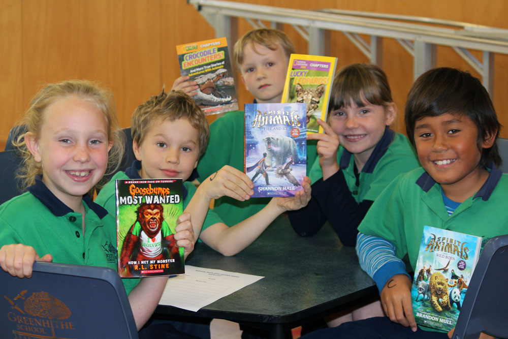Greenhithe School children proudly hold their favourite books from their school library